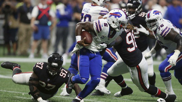 Buffalo Bills quarterback Tyrod Taylor (5) runs around Atlanta Falcons defensive tackle Grady Jarrett (97) during the second half of an NFL football game, Sunday, Oct. 1, 2017, in Atlanta. The Buffalo Bills won 23-17.(AP Photo/John Bazemore)