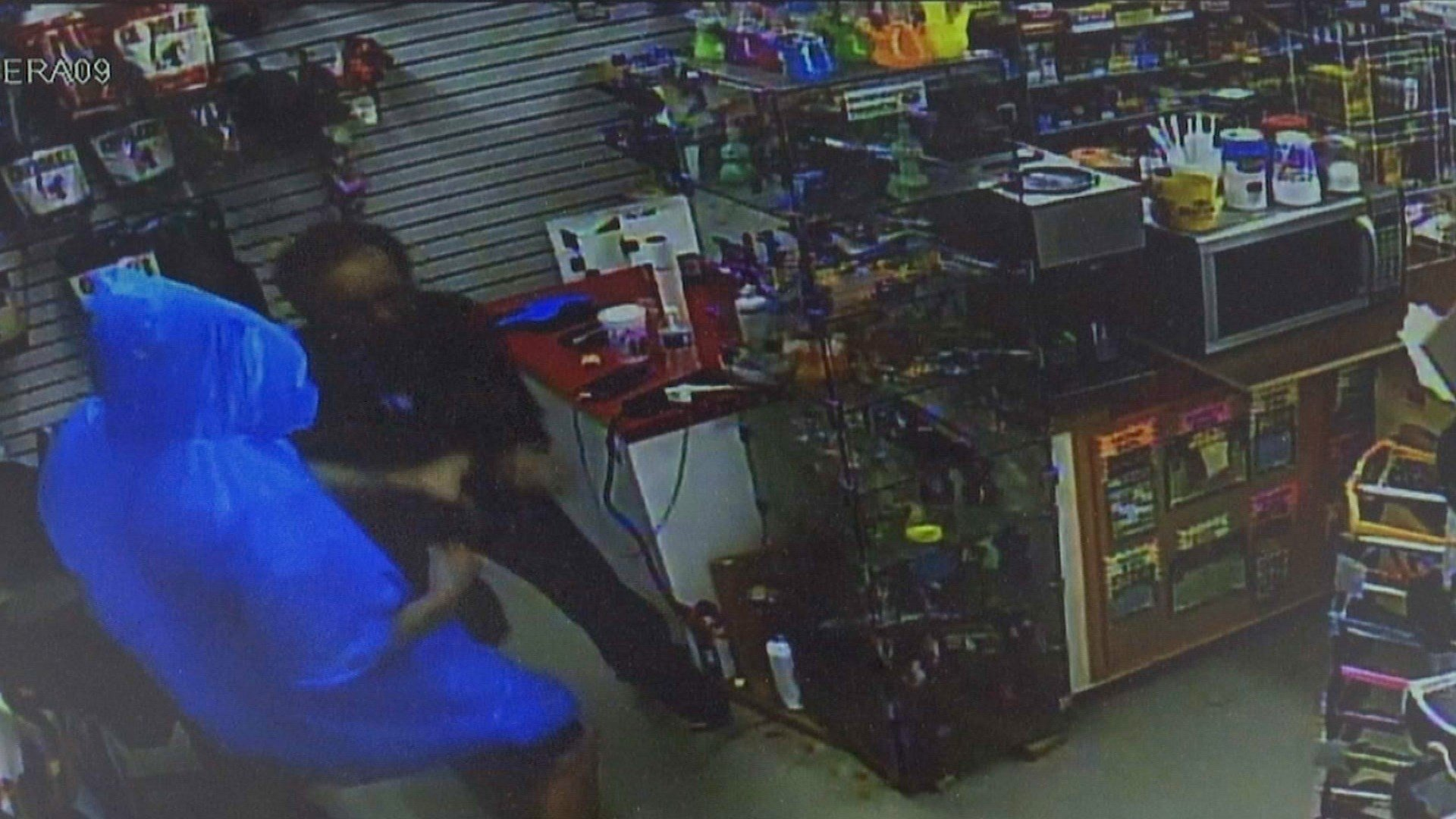 Clerk wrestles with attacker armed with gasoline
