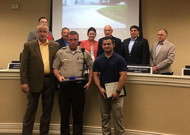Sheriff Gary Gulledge, Deputy Chris Stafford, EMT Hunter Cunningham, Todd Pownall, County Attorney Lani Skipper, Commission Chairman Dave Carmichael, Commissioner Vernon Collett, Commissioner Tony Crowe (Source: Paulding County Sheriff's Office)