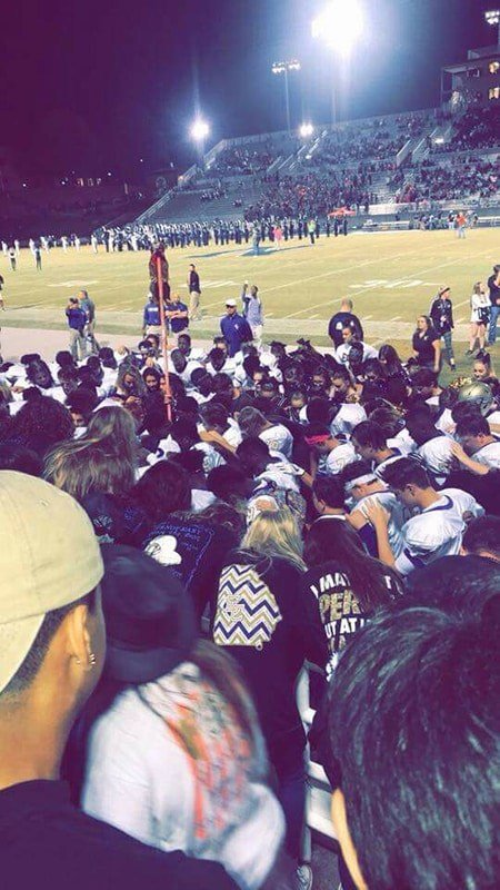 fans pray with the team as coaches stand aside (taken by attendee at East Coweta vs. Newnan)