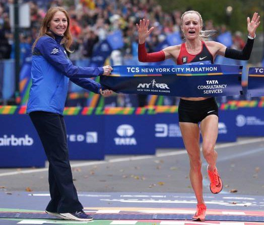 Shalane Flanagan as she crosses the finish line at the 26th New York Marathon. Source: Seth Wenig/Associated Press)