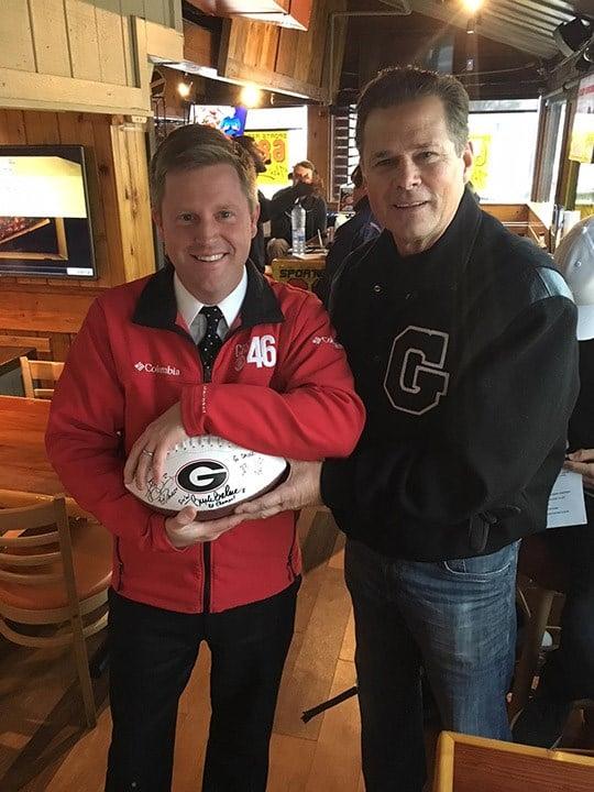 CBS 46 Reporter Adam Murphy and former UGA quarterback Buck Belue. (Source: WGCL)