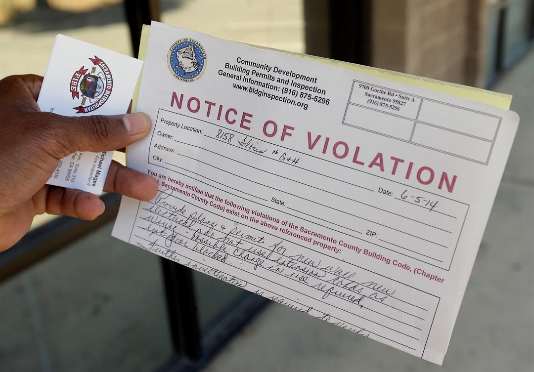 Generic image of code enforcement (Source: AP Images)