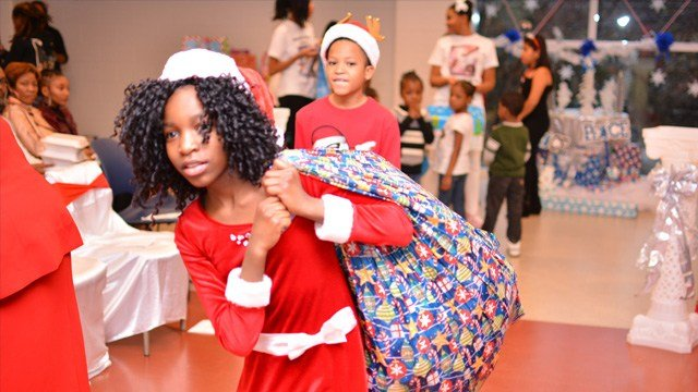 """Heaven Hightower, 12, passing out toys and gifts to more than 40 families at her 3rd annual """"Being a Blessing to Kids in Need Christmas Event"""" The event was held Dec. 17 at the Villages at Carver Family YMCA."""