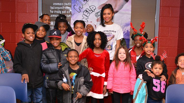 """Holiday smiles from the more than 40 families helped at the 3rd annual """"Being a Blessing to Kids in Need Christmas Event"""" Dec. 17. The event was started by 12-year-old Heaven Hightower as a way to make sure kids have a special Christmas."""