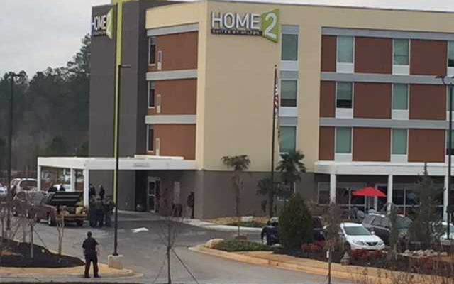 Hotel evacuated after man shoots out glass lobby door