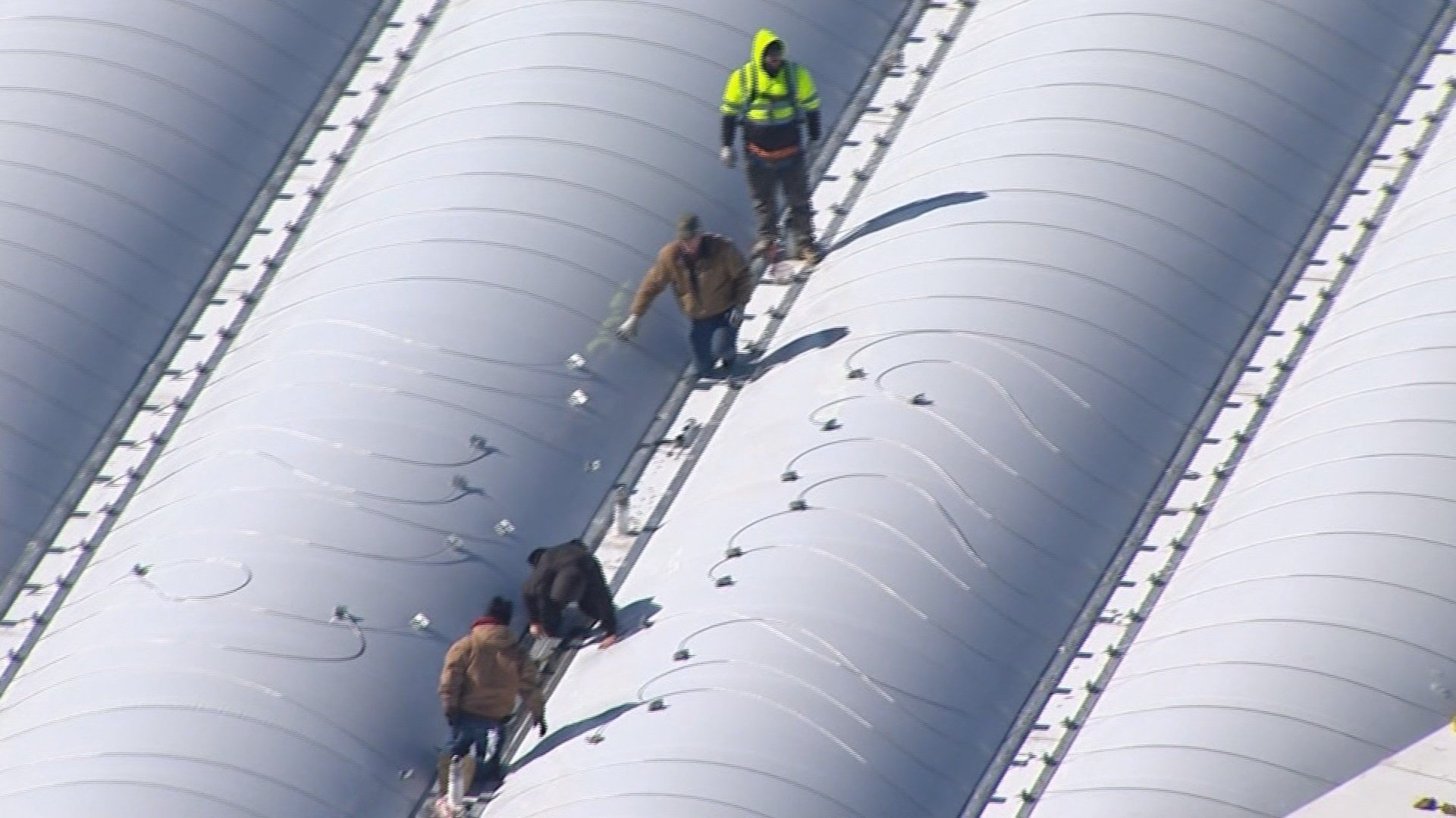 crews are back to work trying to fix the roof at Mercedes Benz stadium (Chopper 46)