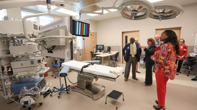 Guests tour one of three operating room suites located in the new 20,000-square-foot surgery center. | Source:  WellStar Health System