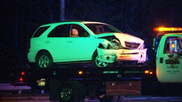 Steve White/CBS Atlanta- A car is removed from the scene of the fatal crash.