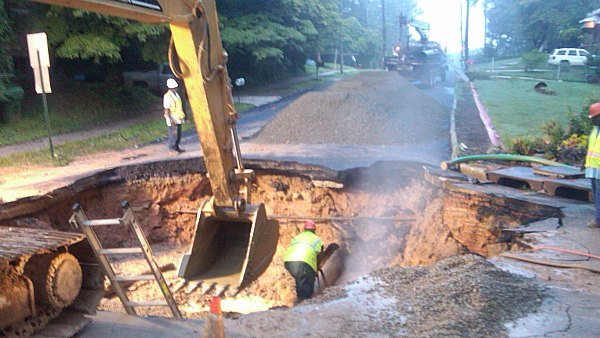 Steve White/CBS Atlanta- Repairing the break has resulted in a huge hole that will need to be filled before the road can re-open.