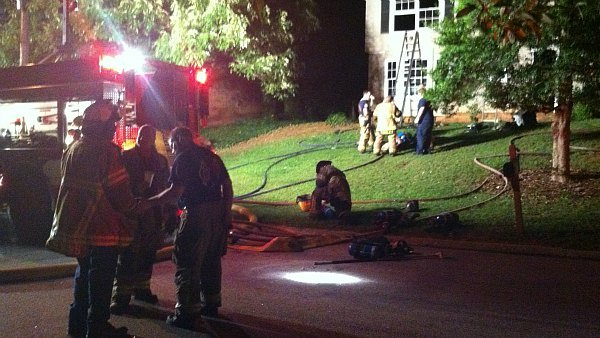 Richard Breaden/CBS Atlanta- Fire crews survey the damage to a DeKalb County home.