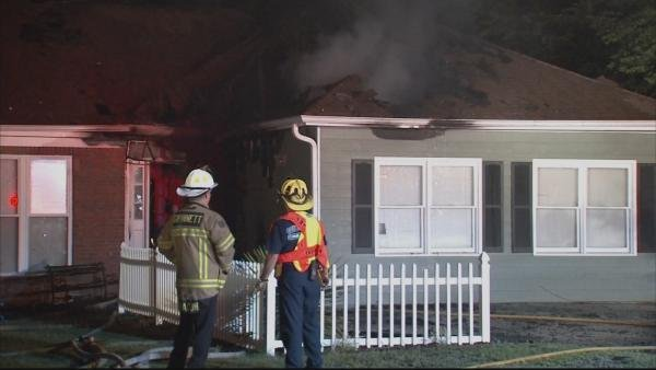 Steve White/CBS Atlanta- Fire crews assess the damage on a Gwinnett County home.