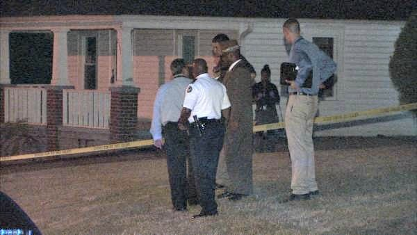 Mark Melvin/CBS Atlanta- Investigators work the scene of a double shooting Monday.