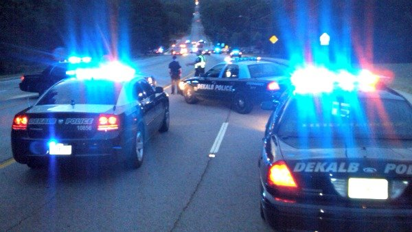 Steve White/CBS Atlanta- DeKalb Police investigate the scene of a police chase that ended in a crash.