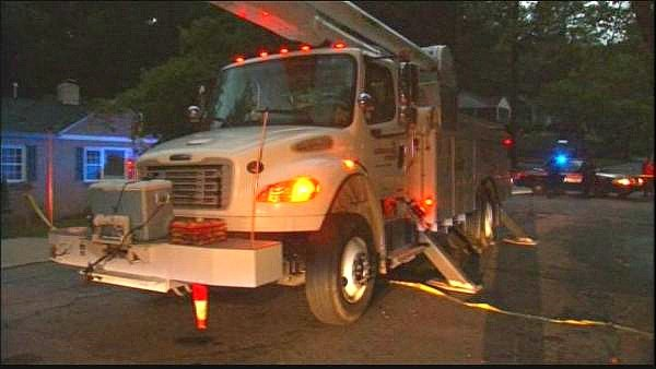Georgia Power crews work to restore service to customers Monday night.