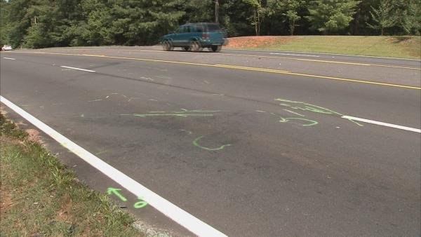 Darren Cook/CBS Atlanta- Crews marked the road during an investigation into the fatal accident.