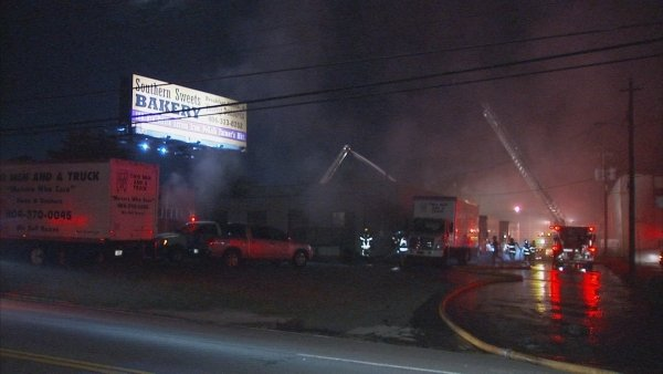 Mark Melvin/CBS Atlanta- Crews worked to extinguish the fire at Two Men and A Truck.