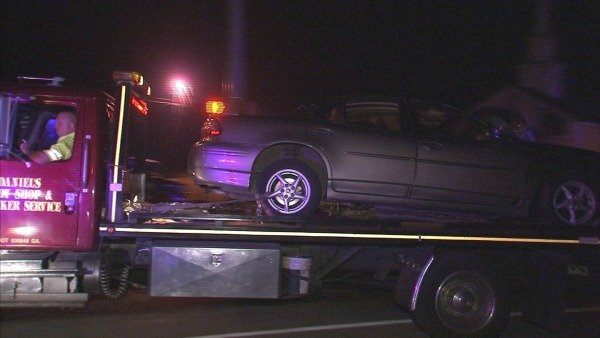 Joe Holland/CBS Atlanta- One of the cars involved is towed from the Cherokee County scene.