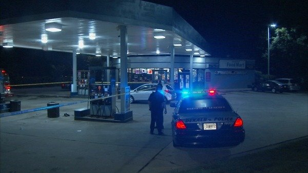Mark Melvin/CBS Atlanta- DeKalb police investigate a gas station shooting early Monday.