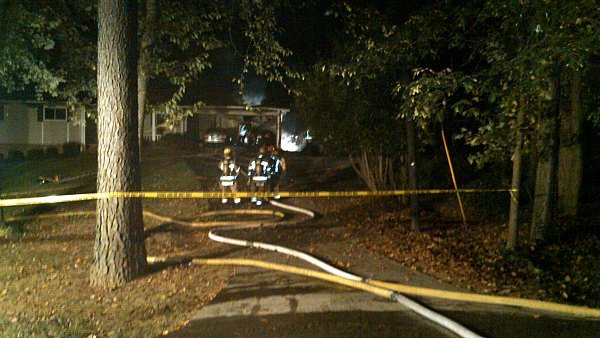 Steve White/CBS Atlanta- Fire crews work to contain an early morning fire at a home on the 3900 block of Pine Needle Drive.