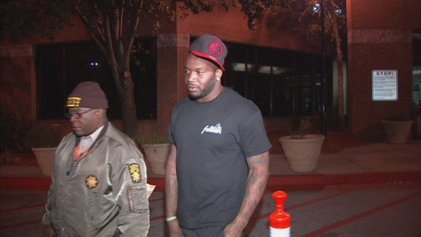 Abraham leaving the Fulton County Jail early Tuesday
