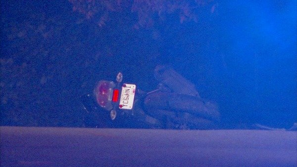 Mark Melvin/CBS Atlanta- The motorcyclist struck a large rock before flipping over at a Midtown intersection.