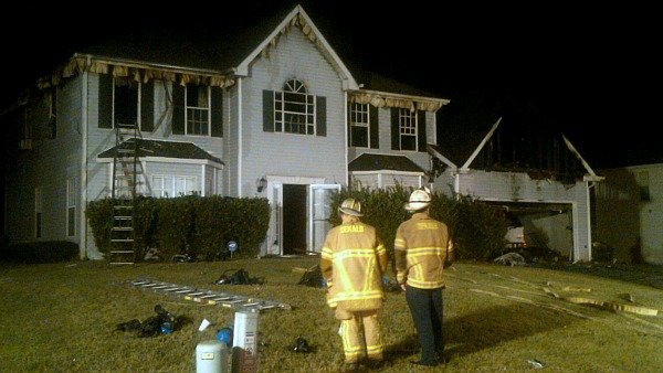 Mark Melvin/CBS Atlanta- Fire crews evaluate the damage at an Ellenwood home early Friday.