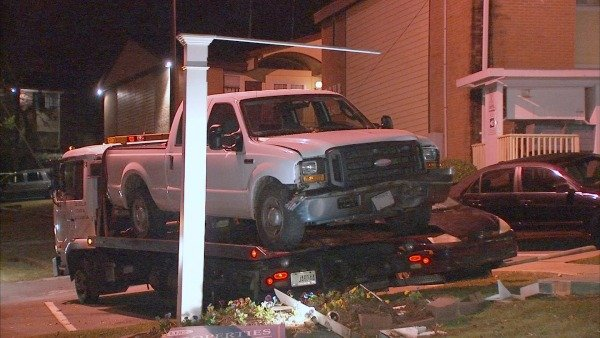 Mark Melvin/CBS Atlanta- A tow truck removes the car two suspects abandoned after driving through a NE Atlanta checkpoint.