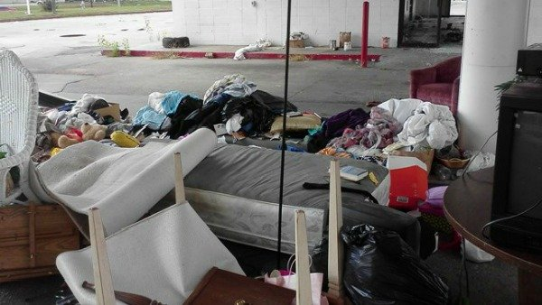 Trash dumped at vacant gas station