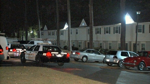 Mark Melvin/CBS Atlanta- Police investigate the scene where a husband is accused of stabbing his wife early Friday.