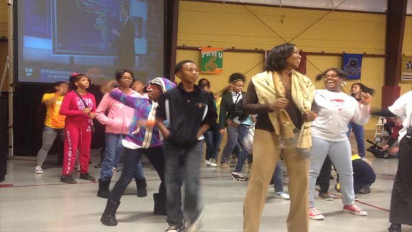 Students and parents dance at Ivy Prep Academy in Kirkwood