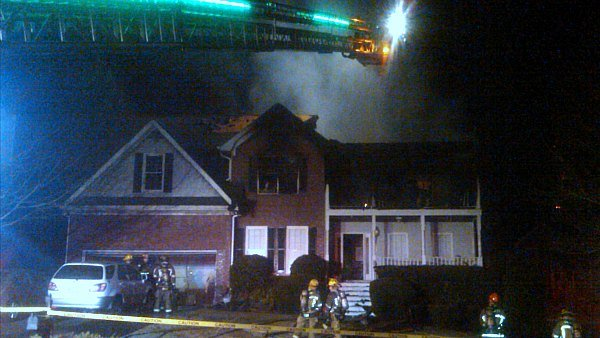 Mark Melvin/CBS Atlanta- Gwinnett County fire crews work to put out an early morning house fire.