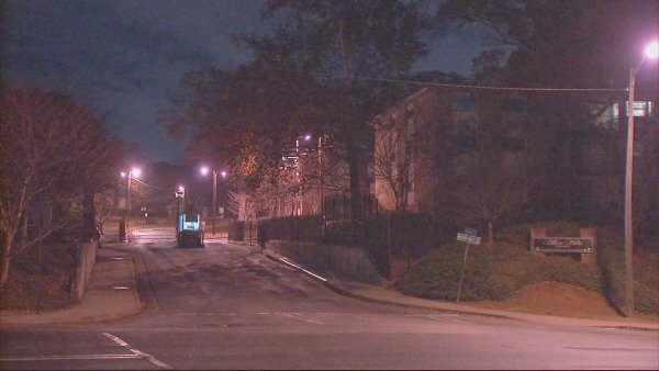 Mark Melvin/CBS Atlanta- Officers work to determine the motive in an overnight shooting at a northwest Atlanta apartment.