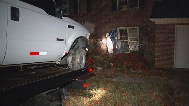 Mark Melvin/CBS Atlanta- No one was injured when the pickup truck struck the abandoned home on South Deshon Court.