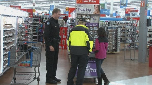"Gene Collins/CBS Atlanta- Alpharetta police officers assist area children as they shop as part of the ""Shop with a Cop"" program Tuesday."