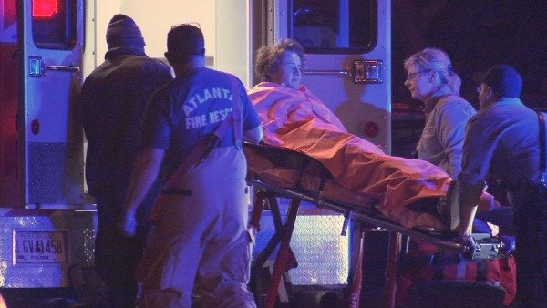 Richard Breaden/CBS Atlanta- A stabbing victim is loaded into an ambulance on Freedom Parkway.