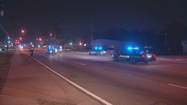 Mark Melvin/CBS Atlanta- Police investigate the scene where a pedestrian was struck early Monday.