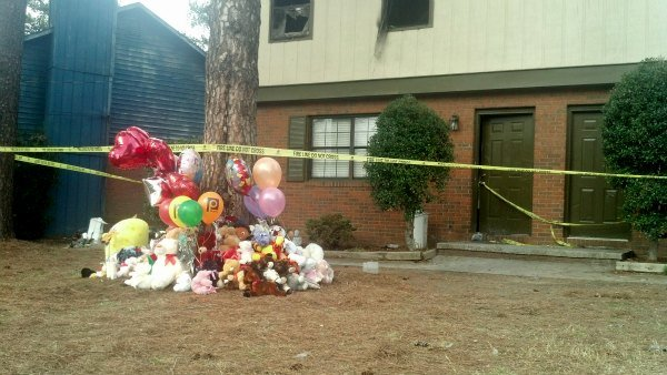 Community members left toys and balloons in front of the children's home