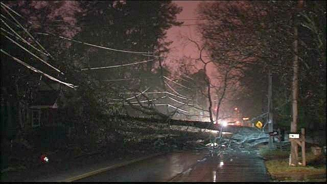 Mark Melvin/CBS Atlanta- Crews worked to restore power and clear power lines and debris from the road.