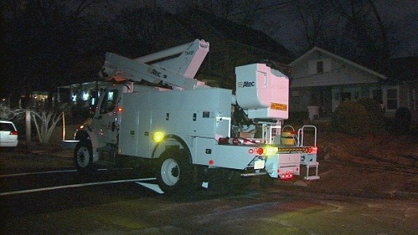 Mark Melvin/CBS Atlanta- Power crews work to restore power to thousands across the state early Thursday.