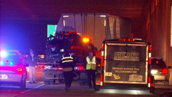 Mark Melvin/CBS Atlanta-- A Clayton County police cruiser is loaded onto a tow truck as officers work to clear the scene on I-285 early Wednesday.