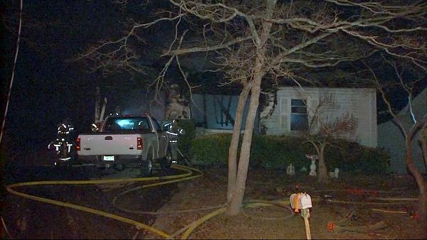 Mark Melvin/CBS Atlanta- A firefighter was injured while battling a northwest Atlanta house fire.