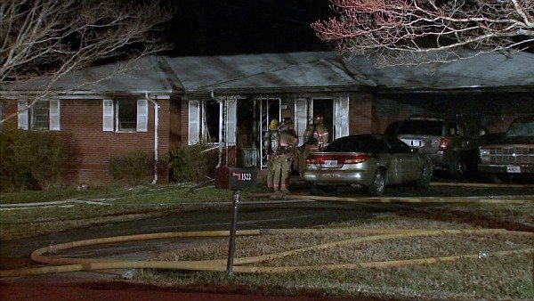 Joe Holland/CBS Atlanta- Two adults and a child escaped early morning flames at their Thunderwood Lane home.