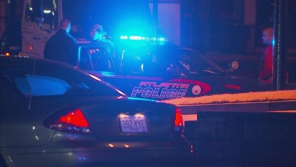 Police question a man about the overnight shooting.