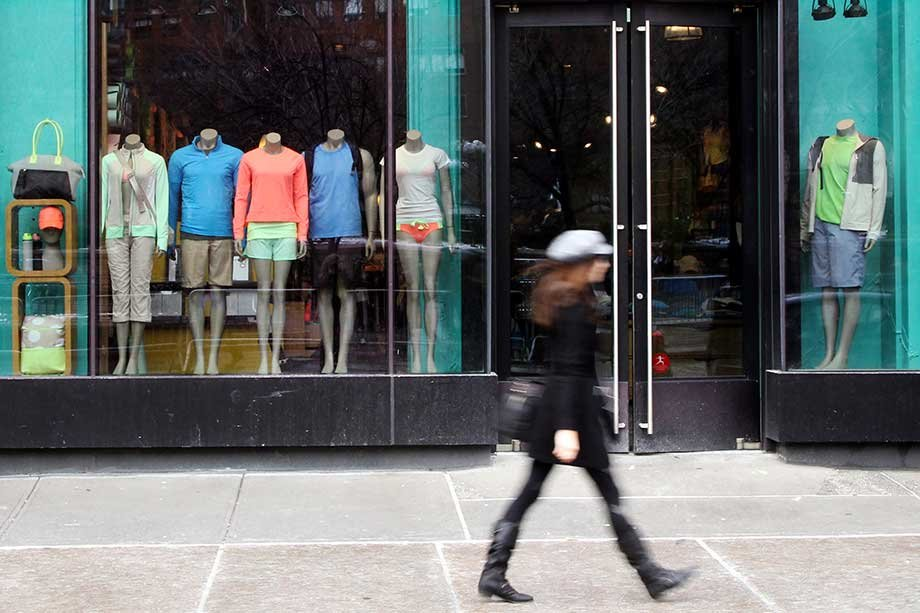 A woman walks past the Lululemon Athletica store in NYC.