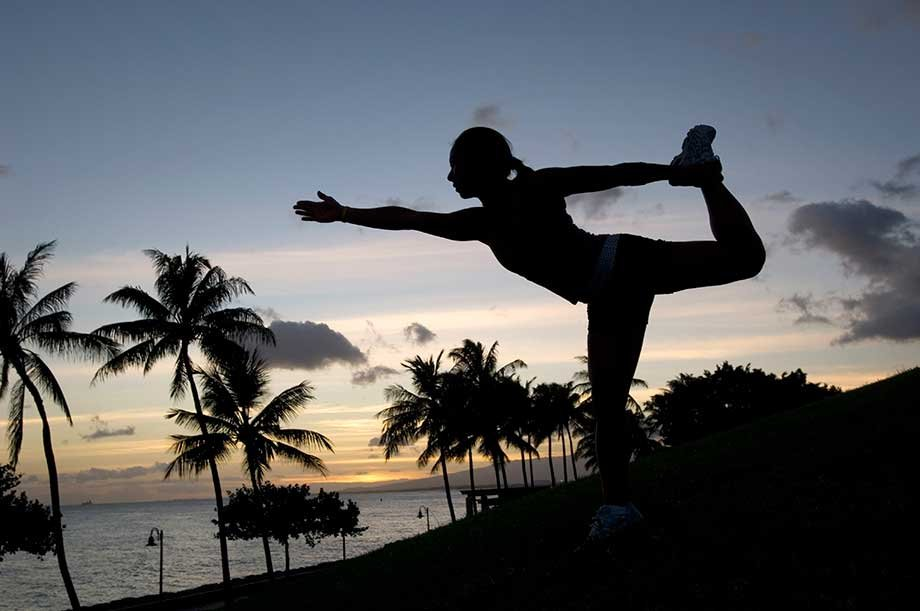 In this photo released by Lululemon Athletica, Angela Yamashita strikes a dancers pose at the end of a sunset photo shoot in Hawaii in 2007.