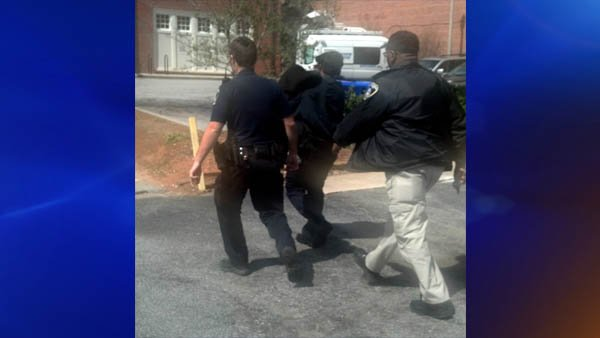 Stone Mountain police transport the little girl at the police station