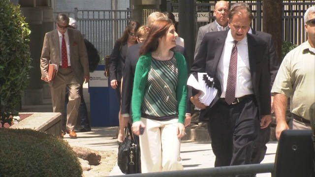 Andrea Sneiderman with her attorney J.Tom Morgan, a former DeKalb County District Attorney