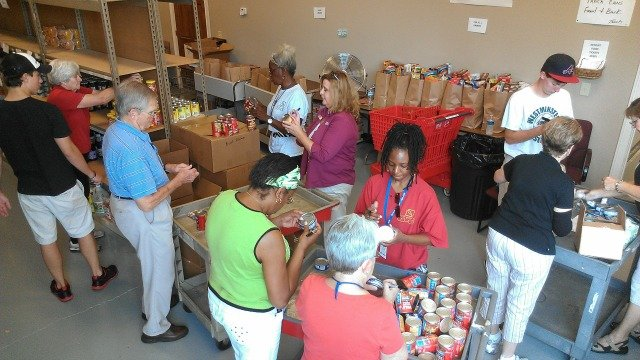 Volunteers stock shelves at North Gwinnett Co-Op