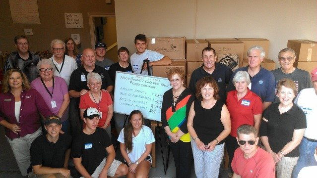Brad and Katherine Cary (back row, left) with volunteers